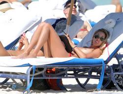 http://img217.imagevenue.com/loc714/th_260237627_lauren_stoner_bikini_topless_march19_2012_45_123_714lo.jpg